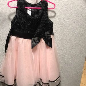 Girl pink and black dress with floral embodiment
